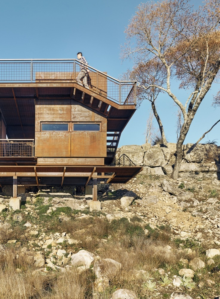 The stairs and walkways that wrap around the cabin lead up to the perfect vantage point