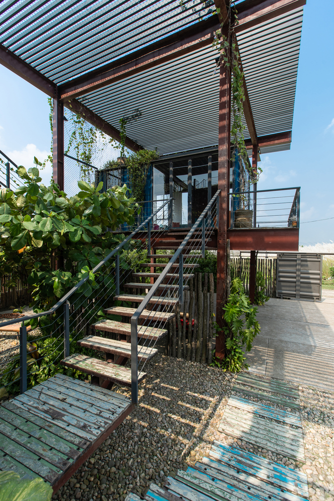The residence has unusually large decks and terraces connected with wood and steel staircases