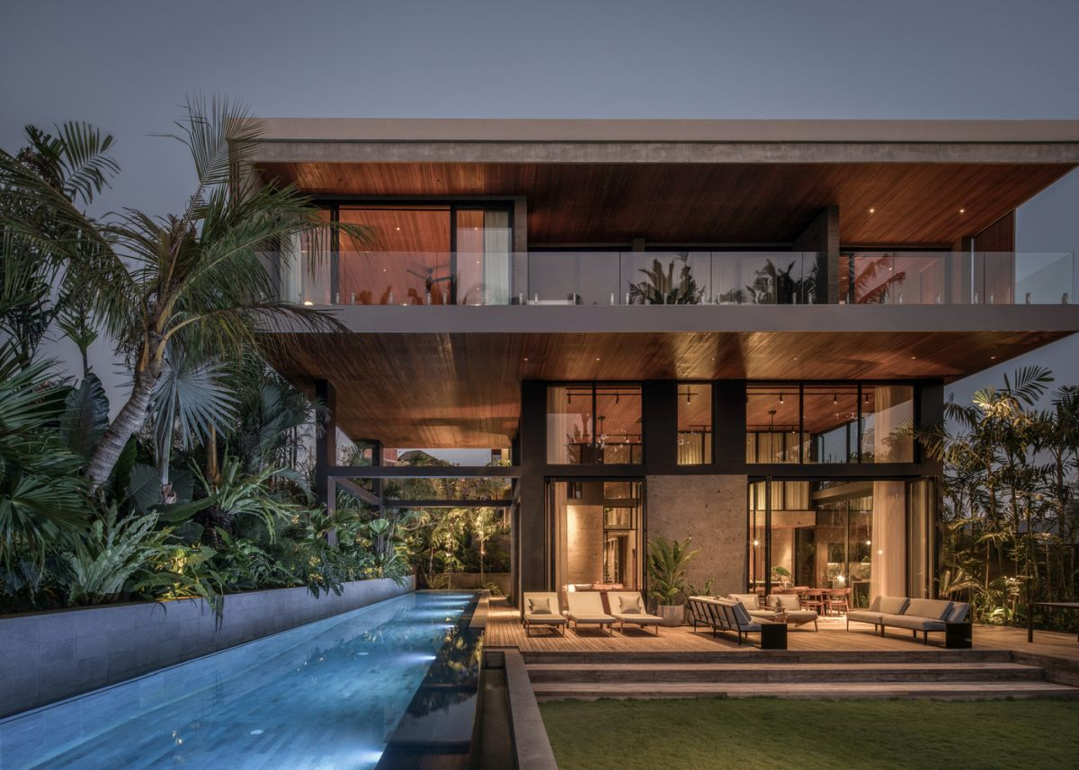 The overall design of the house is modern and linear, with emphasis on simple geometry