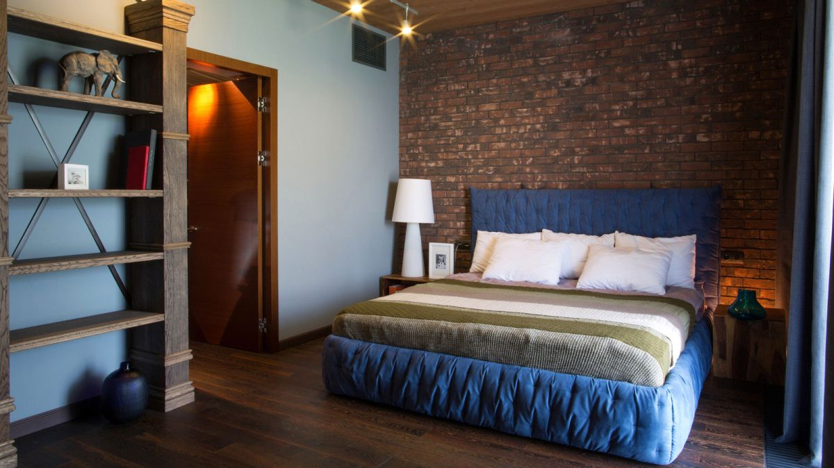 Rostov house by Chado master bedroom blue accent