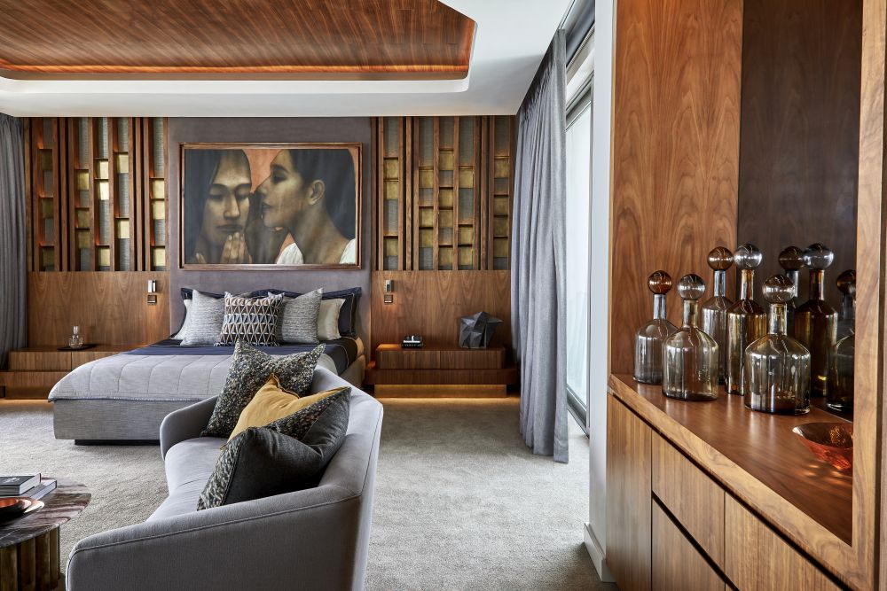 The uppermost floor houses the master bedroom suite, serving as a private quarters for the owners