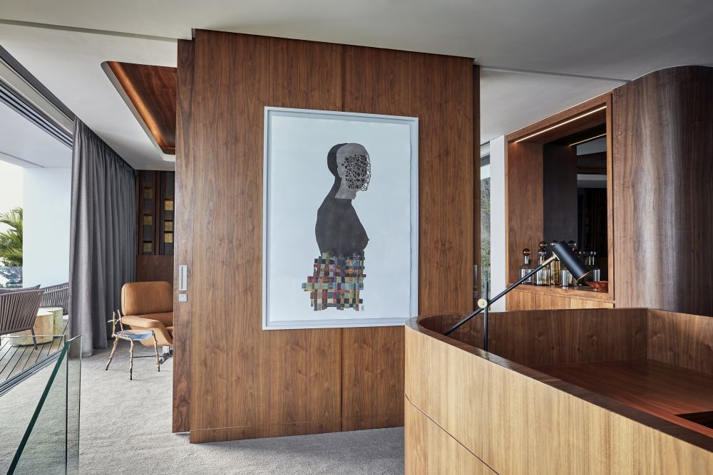 Contemporary artwork is displayed in key areas throughout the house