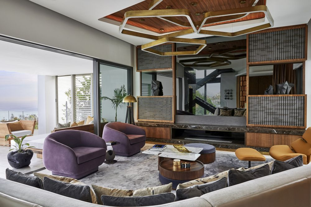 The living room layout and overall design are focused on comfort and seamless transitions