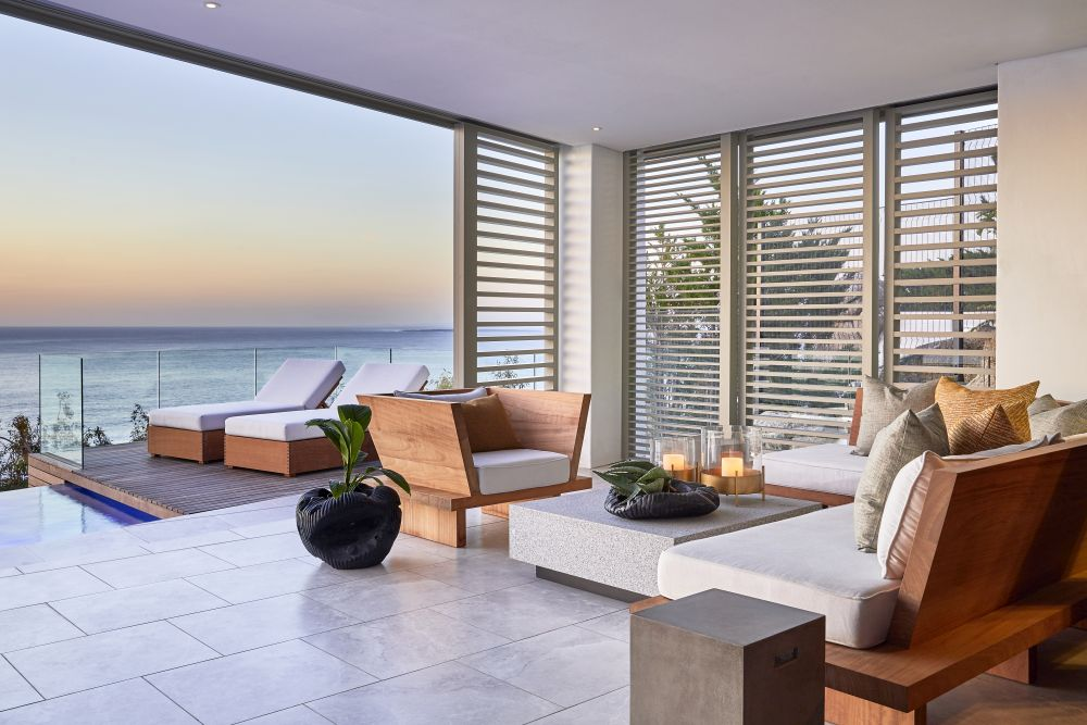 The indoor-outdoor transition is natural and seamless and the house features two breezy entertainment areas