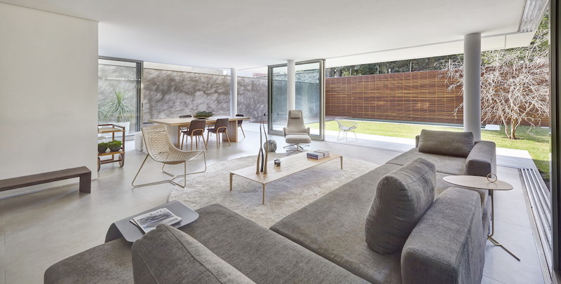 The internal spaces are open and bright, with layouts focused on openness and simplicity