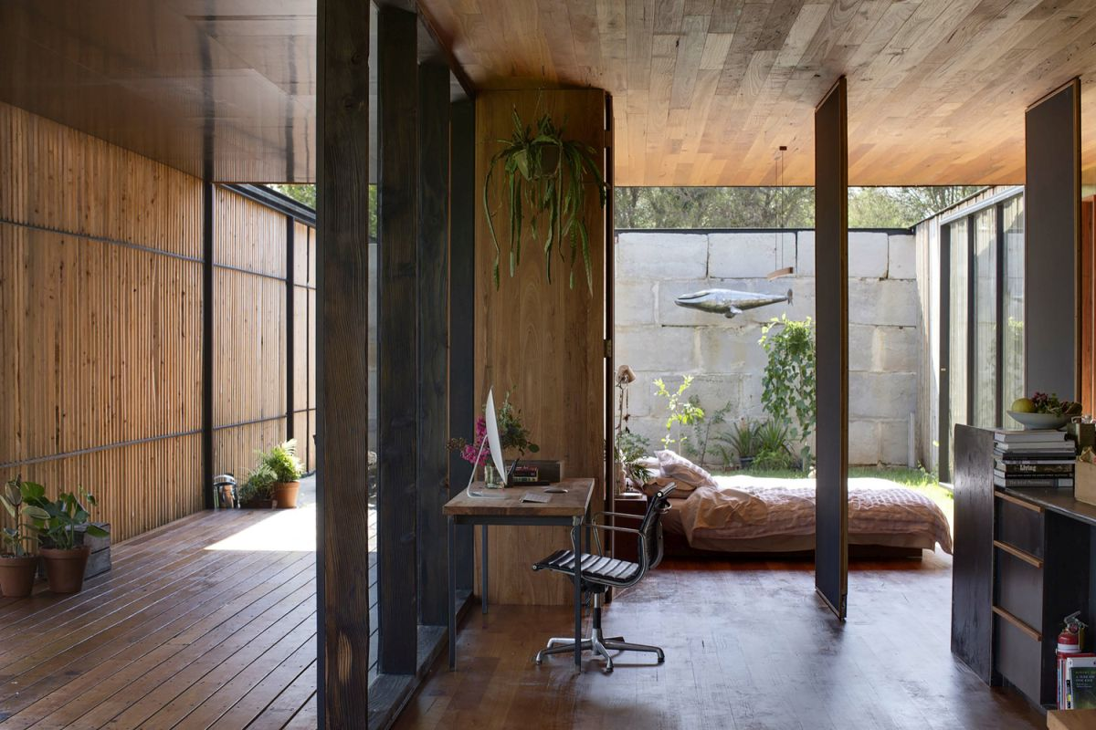 SawMill House bedroom pirvot wall partitions