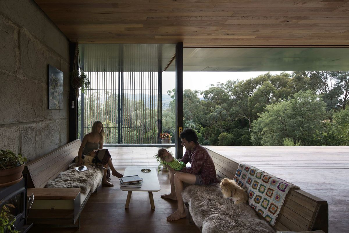 SawMill House living room opened deck wall