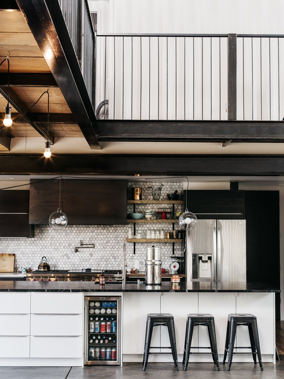 The open kitchen includes a large island with lots of built-in storage