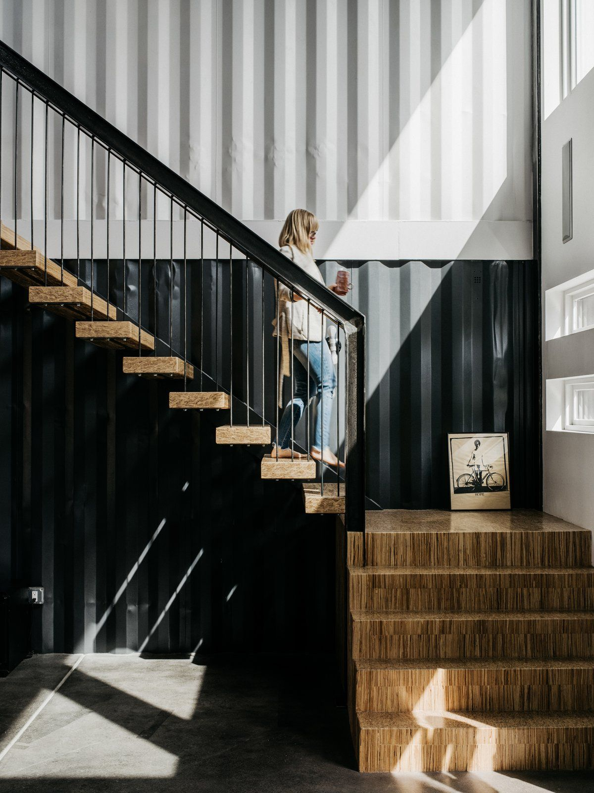 The cold and rugged nature of the metal container frames is balanced by lots of warm wood