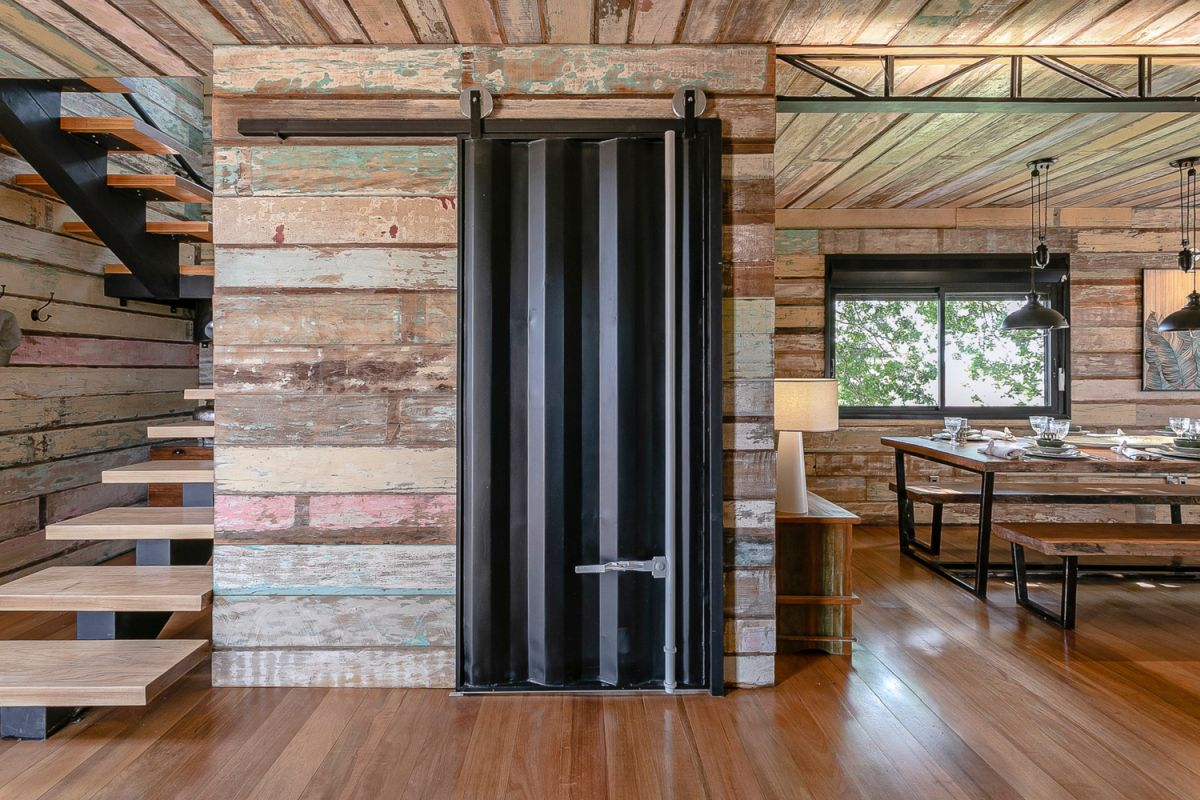 The interior doors are made out of plates from the leftover shipping container pieces