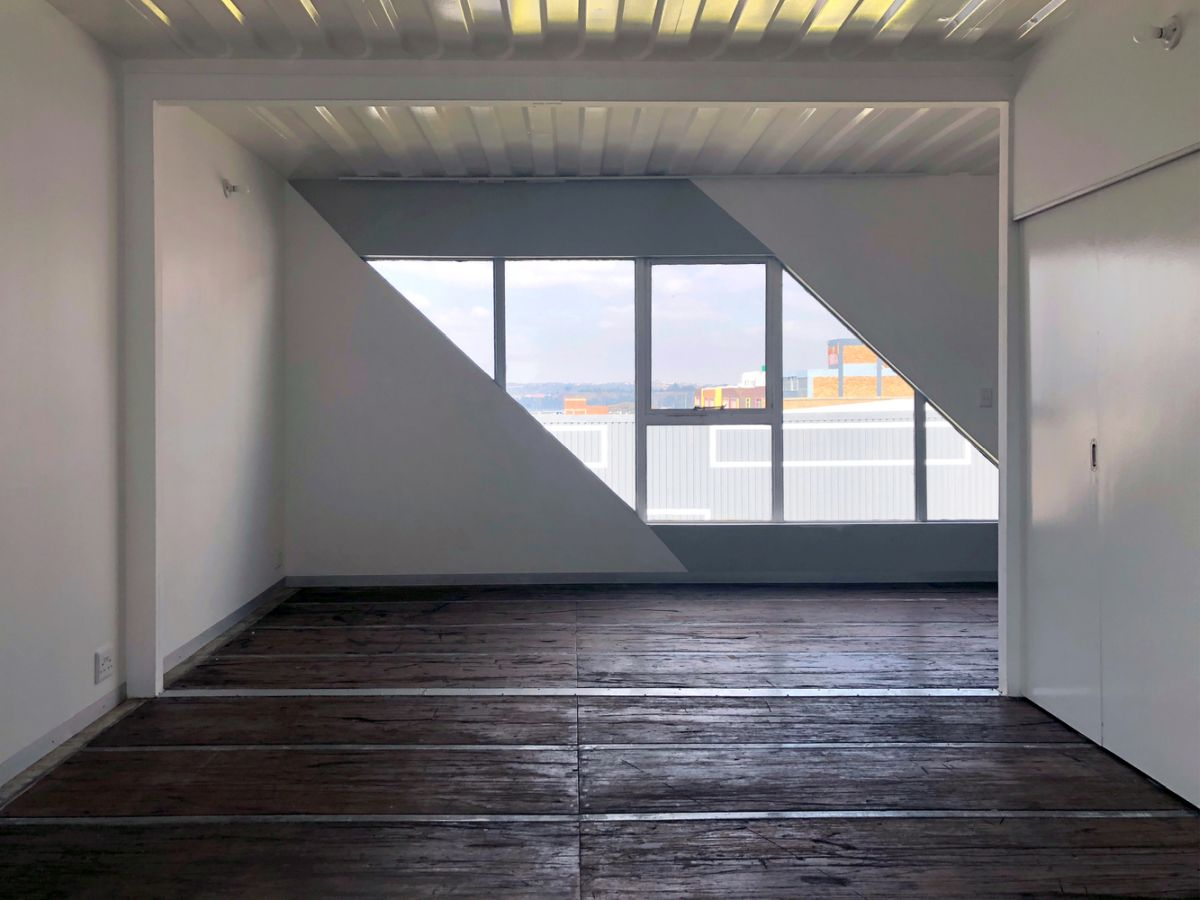 The interiors of the units are simple, featuring reclaimed wood floors and painted metal ceilings