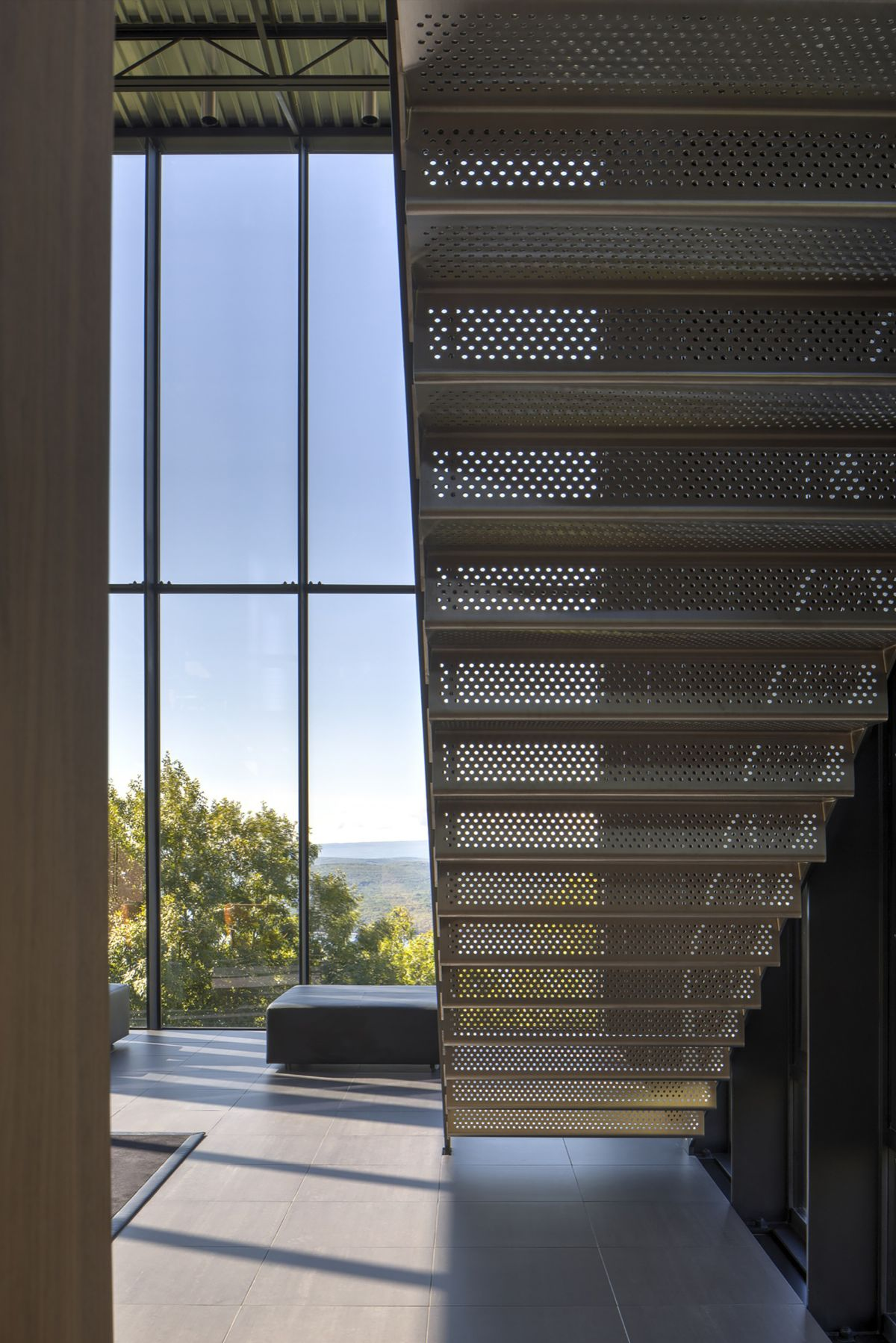Shokan House with perforated steel stairs