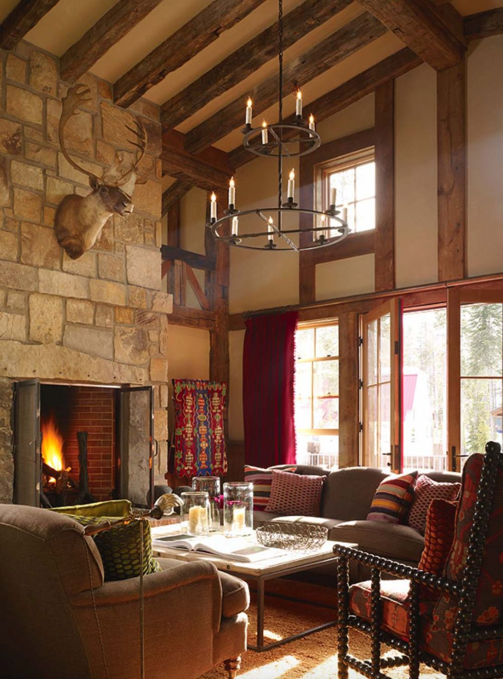 The living room features a massive stone-clad fireplace which makes the whole space look and feel warm and cozy
