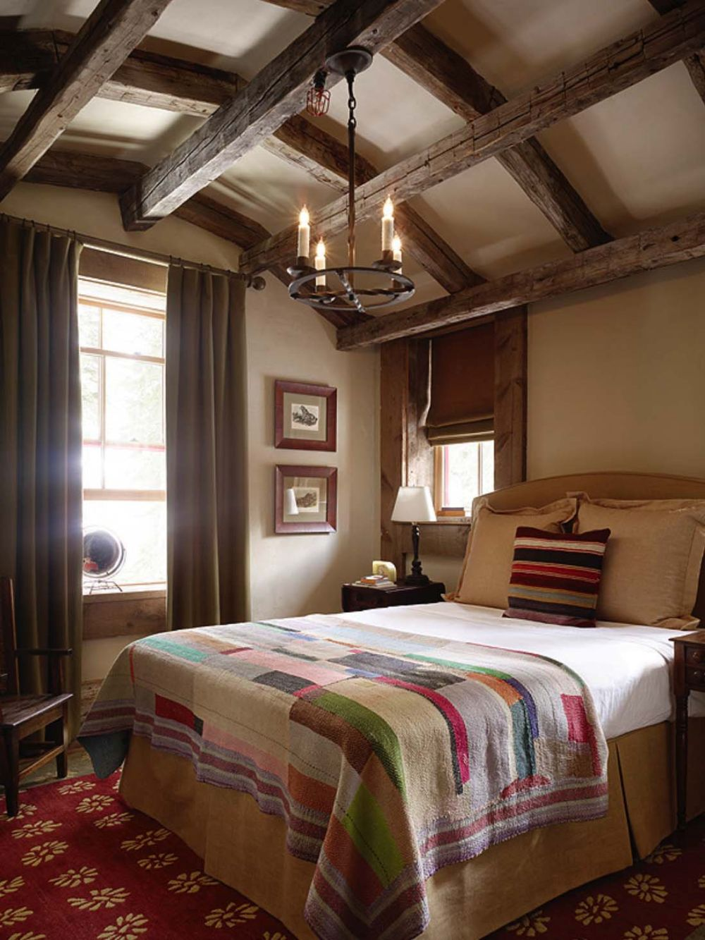 The ceiling beams and curved roofline give the bedroom a very cozy and comfortable look