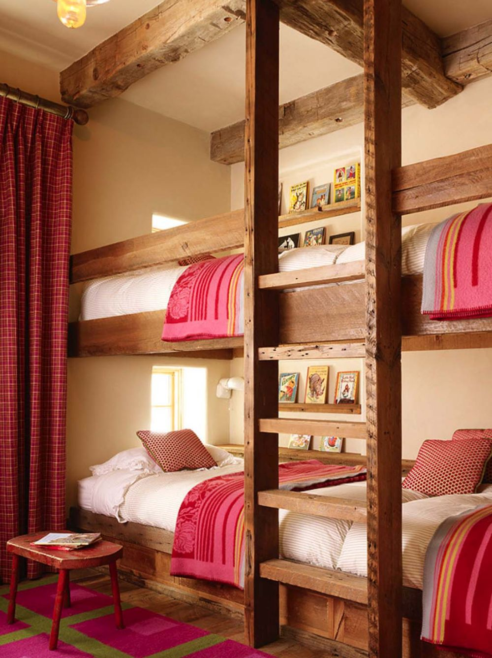 The built-in bunk beds maximize the bedroom's floor space and give it a playful feel