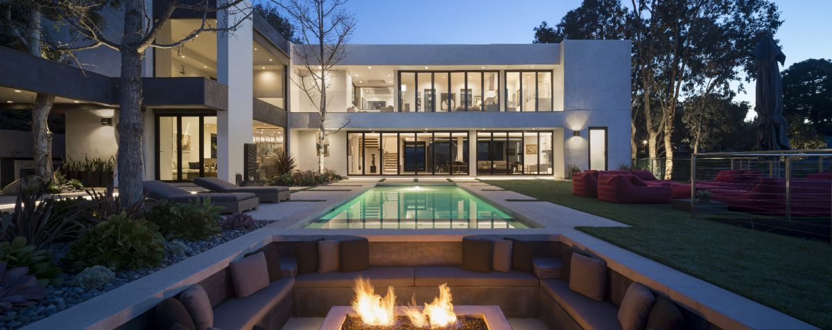 Perfect for entertaining, the outdoor area includes a luxury fire pit and swimming pool.