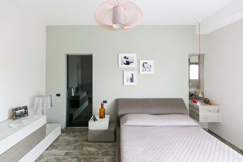 The bedroom's interior design combines several very subtle color tones and a series of different textures