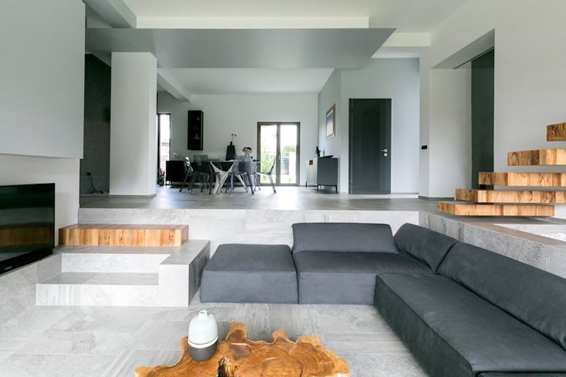The sunken living room is still part of the open floor plan but occupies its own separate zone