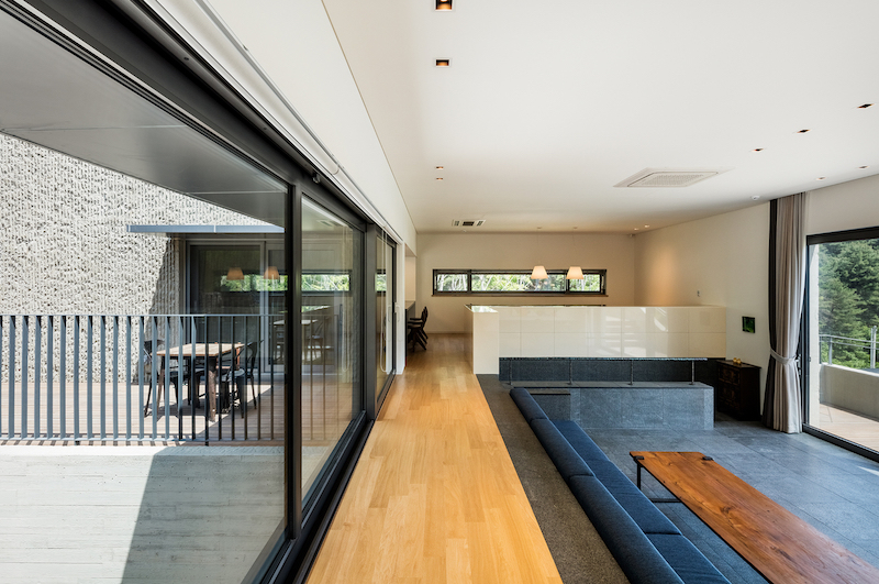 The sunken living area has an adjacent terrace and beautiful views of the surroundings