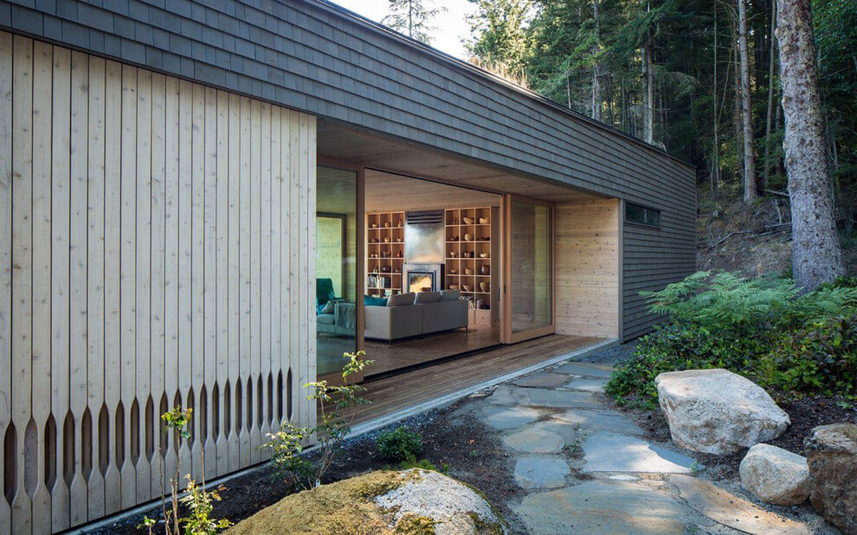 The Lone Madrone retreat living room opens to the outdoors
