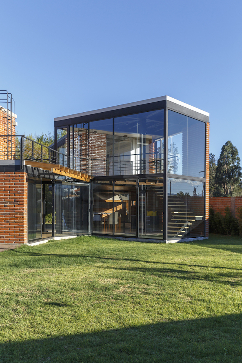 There's a lot of glass used throughout the residence in combination with steel and bricks