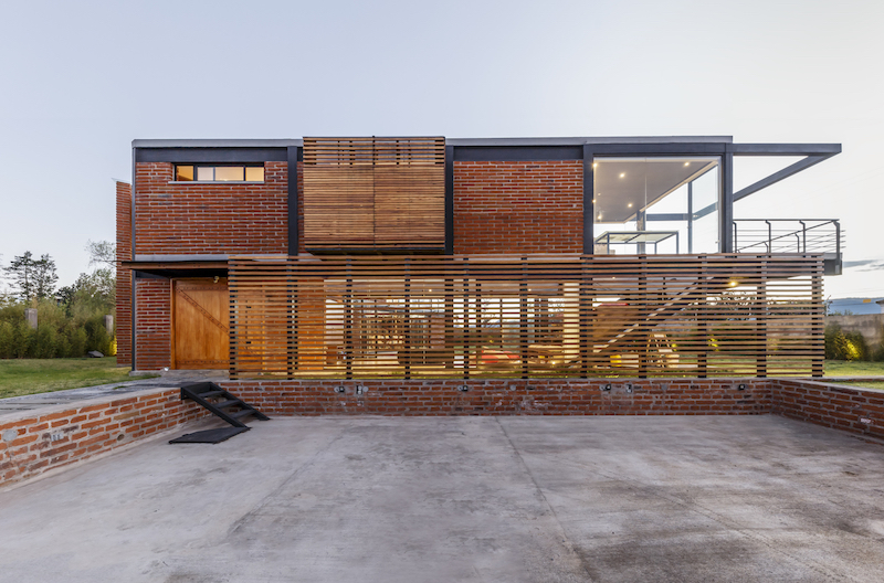 The building has a stainless steel structure with baked bricks used for the exterior walls along with glass
