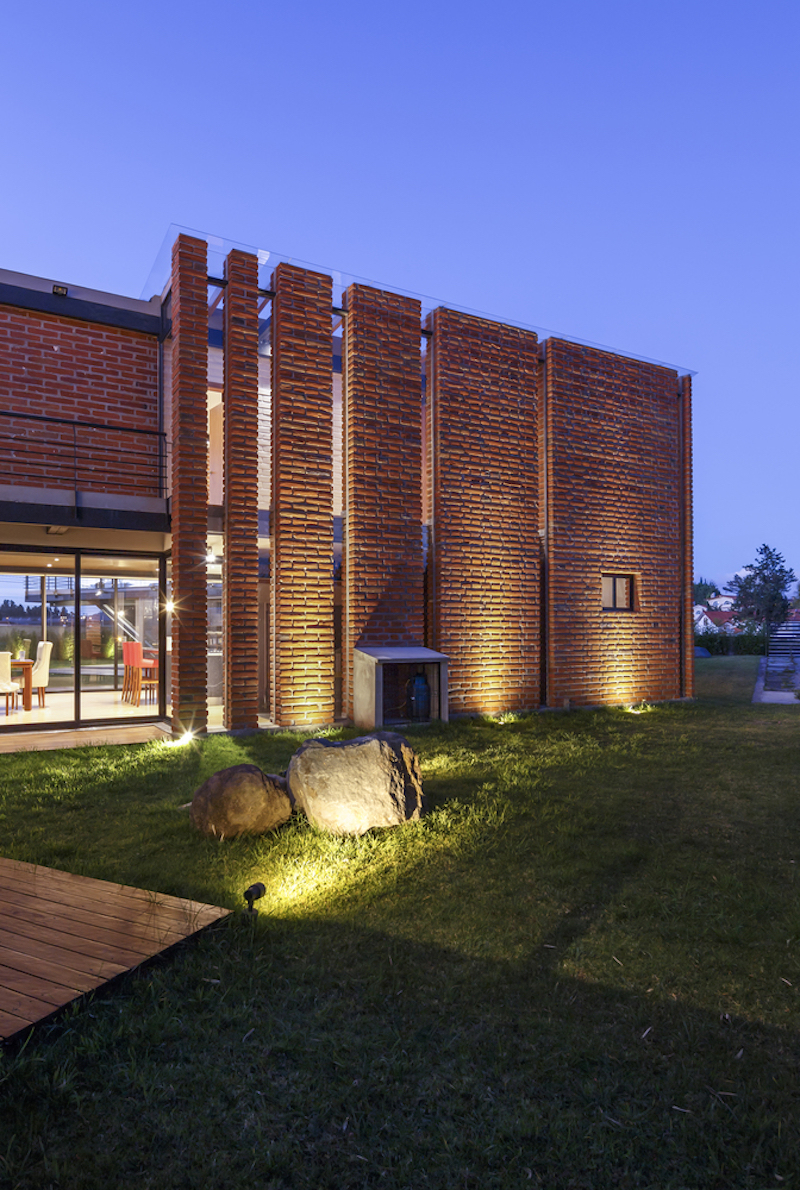 The overall architecture and design of the house are a combination of industrial and rustic elements