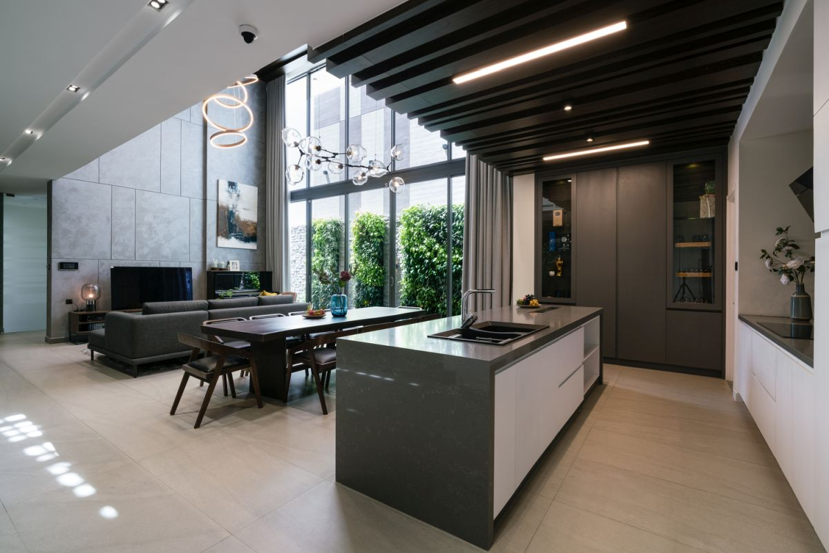 The kitchen island acts as a divider between the cooking area and the rest of the floor plan