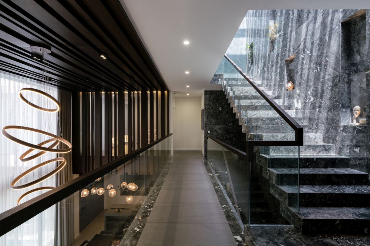 The staircase is one of the major focal points of the residence along with the lighting fixtures