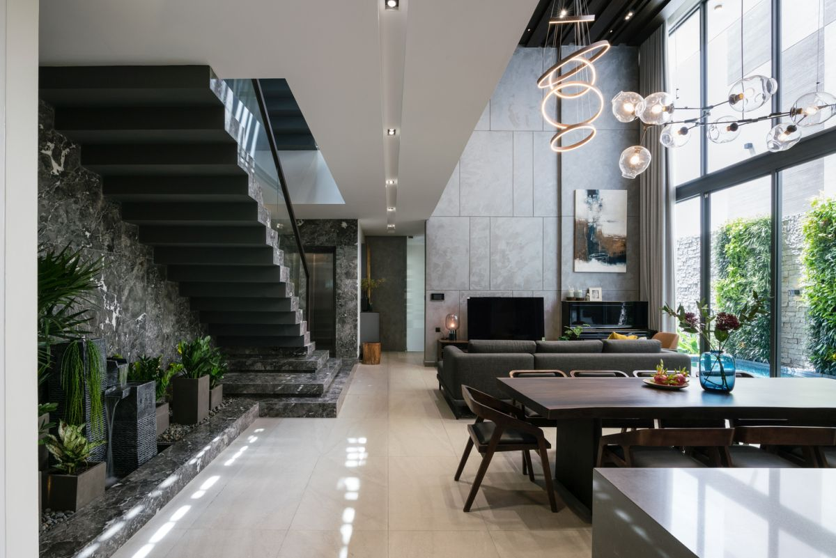 The delicate and sculptural light fixtures draw the eye up and complement the interior decor in a really wonderful manner