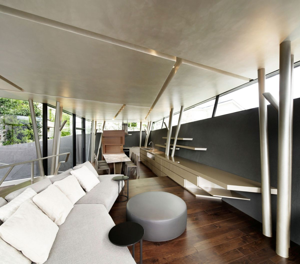 The SRK residence in Tokyo has embelled light fixtures in the ceiling