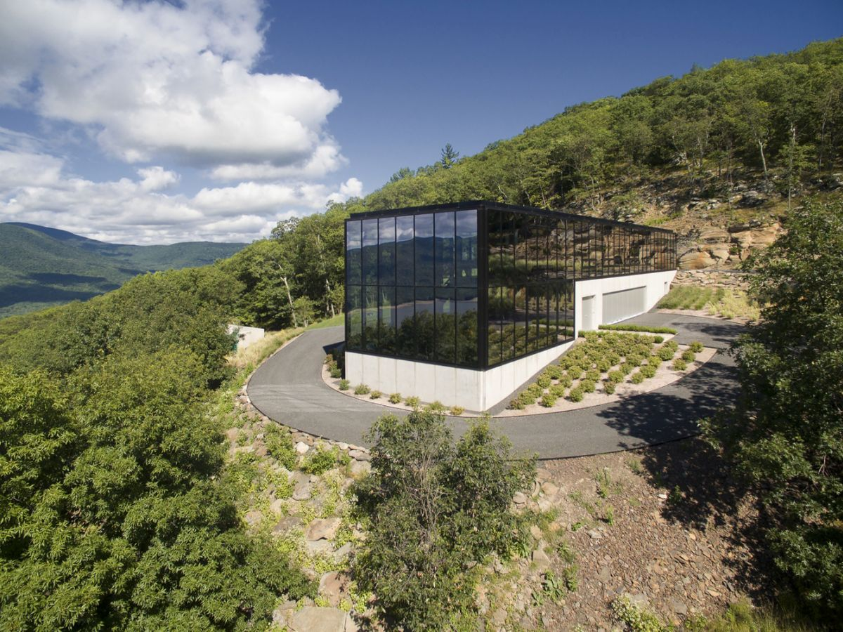 The Shokan House surrounded by forest