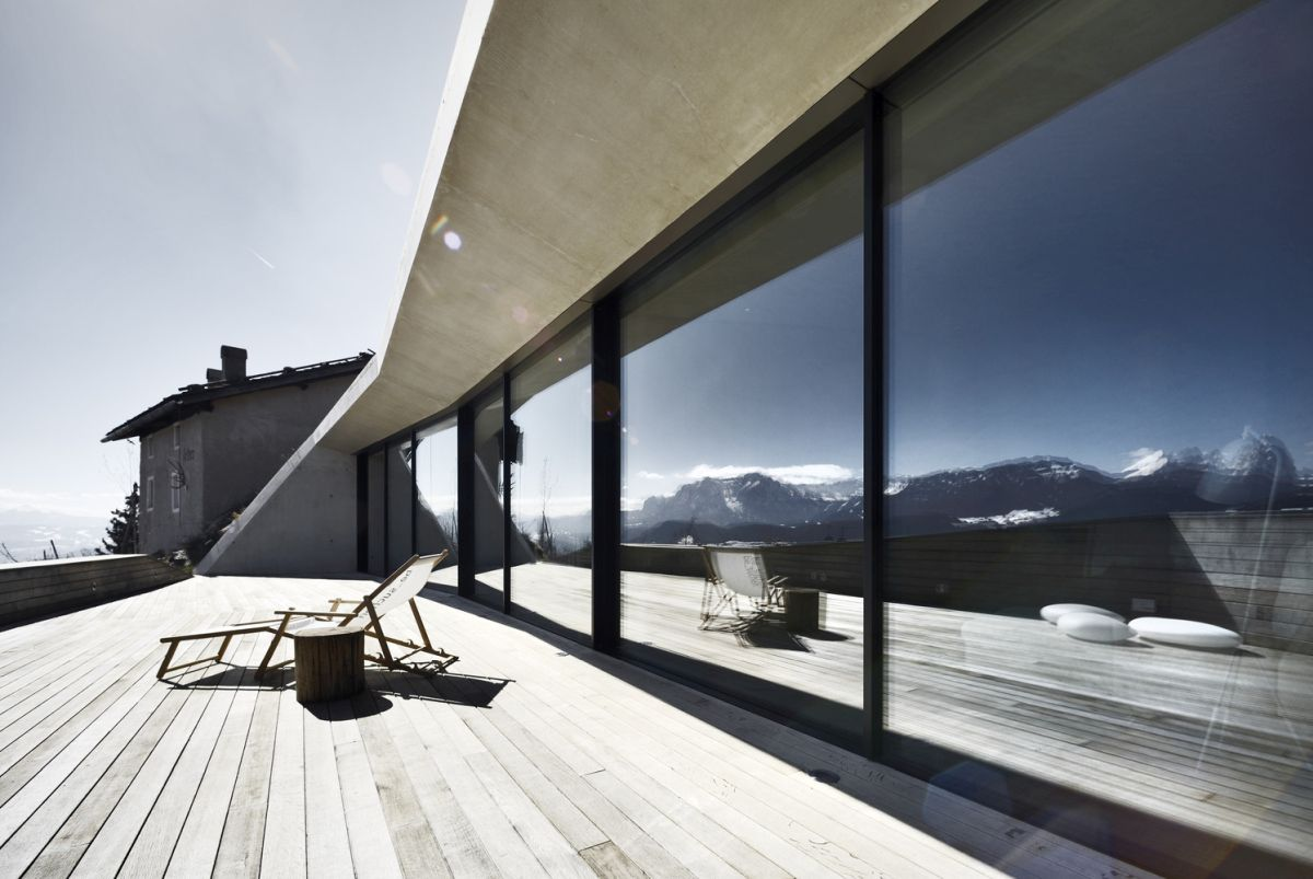 The extension has a glazed facade with full-height windows and sliding doors that reflect the wonderful panorama