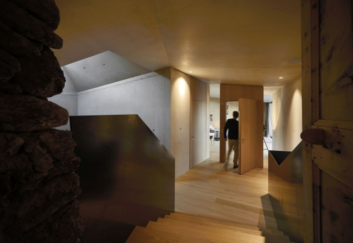 A combination of natural stone, wood and concrete give the new building an eclectic character