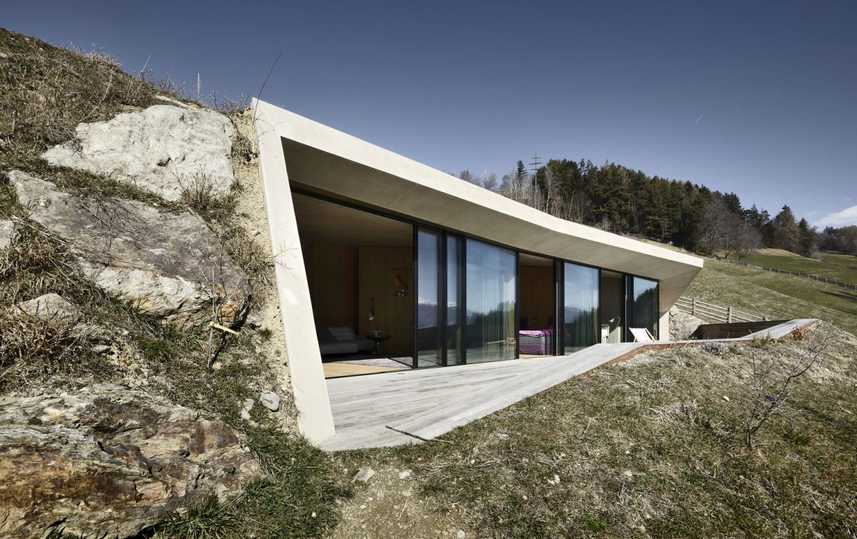 The new structure is buried into the hillside and opens up towards the valley