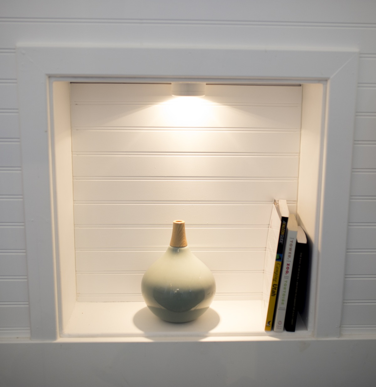 The area underneath the sink can be used as a display nook for a few decorations