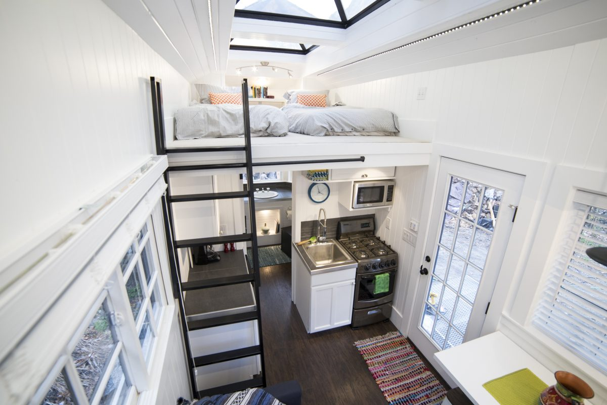 The interior is small but airy thanks to the high ceiling and all the skylights installed on it
