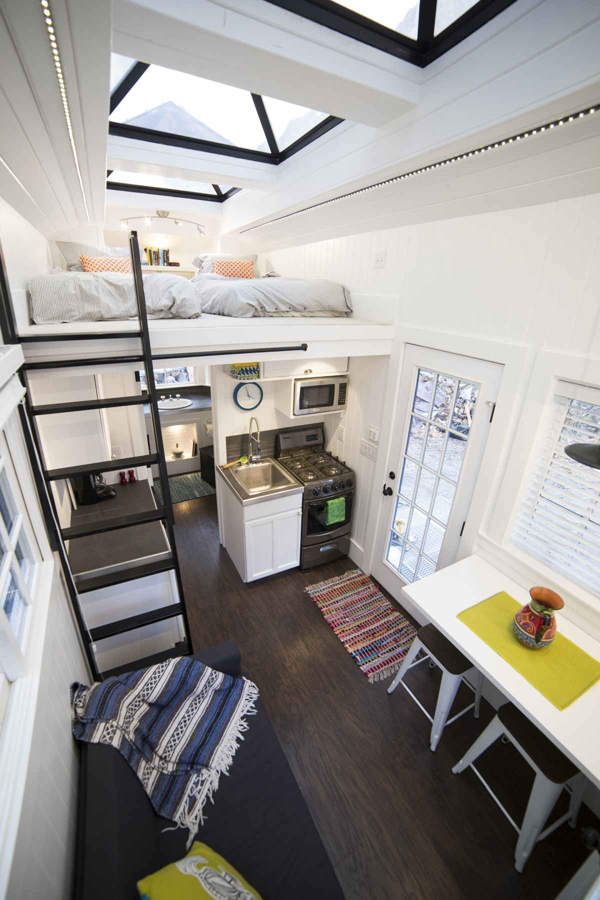 The loft bedroom can be reached by climbing a ladder