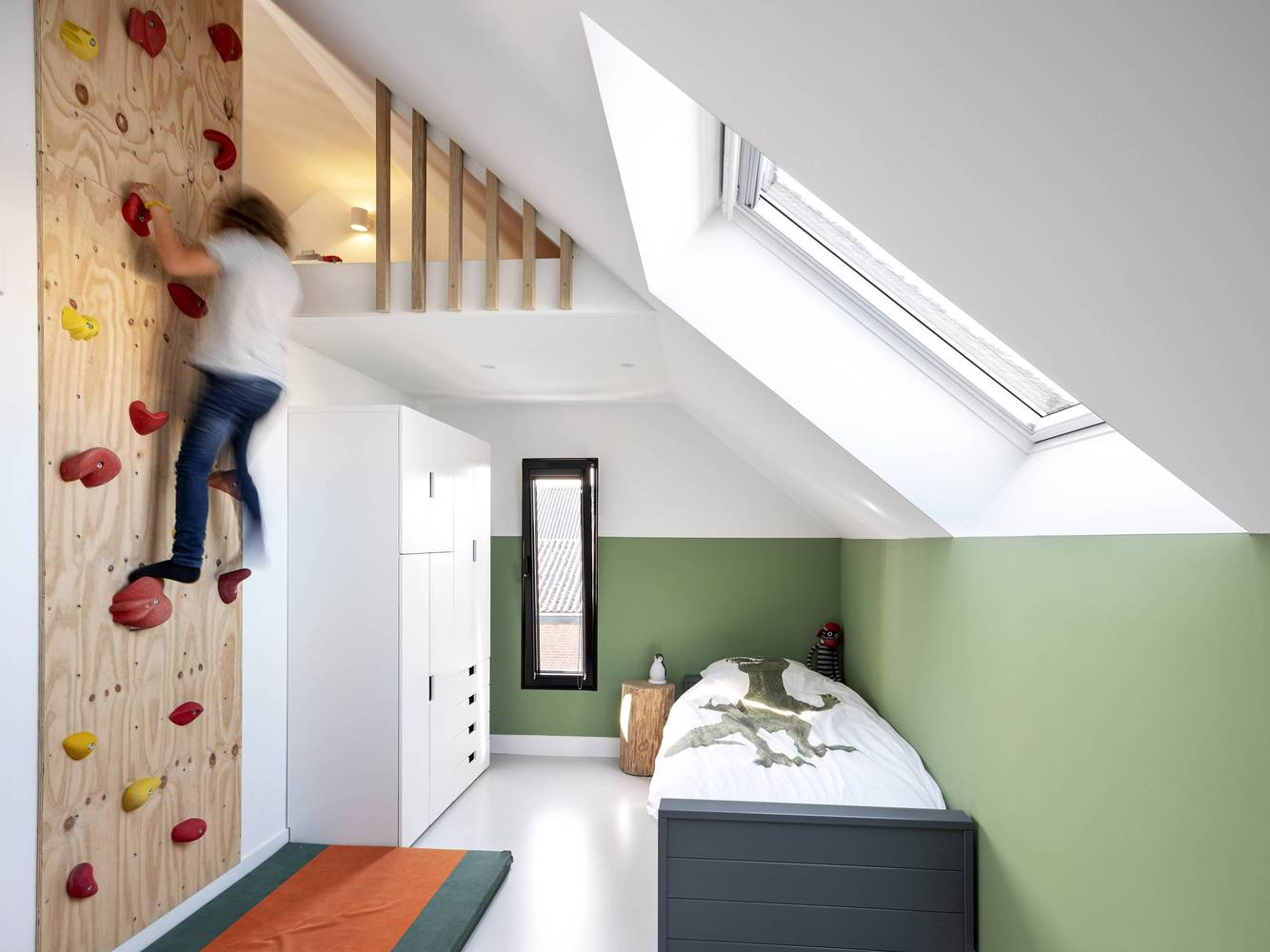 The upstairs bedrooms are decorated with lots of fun features too, like this climbing wall