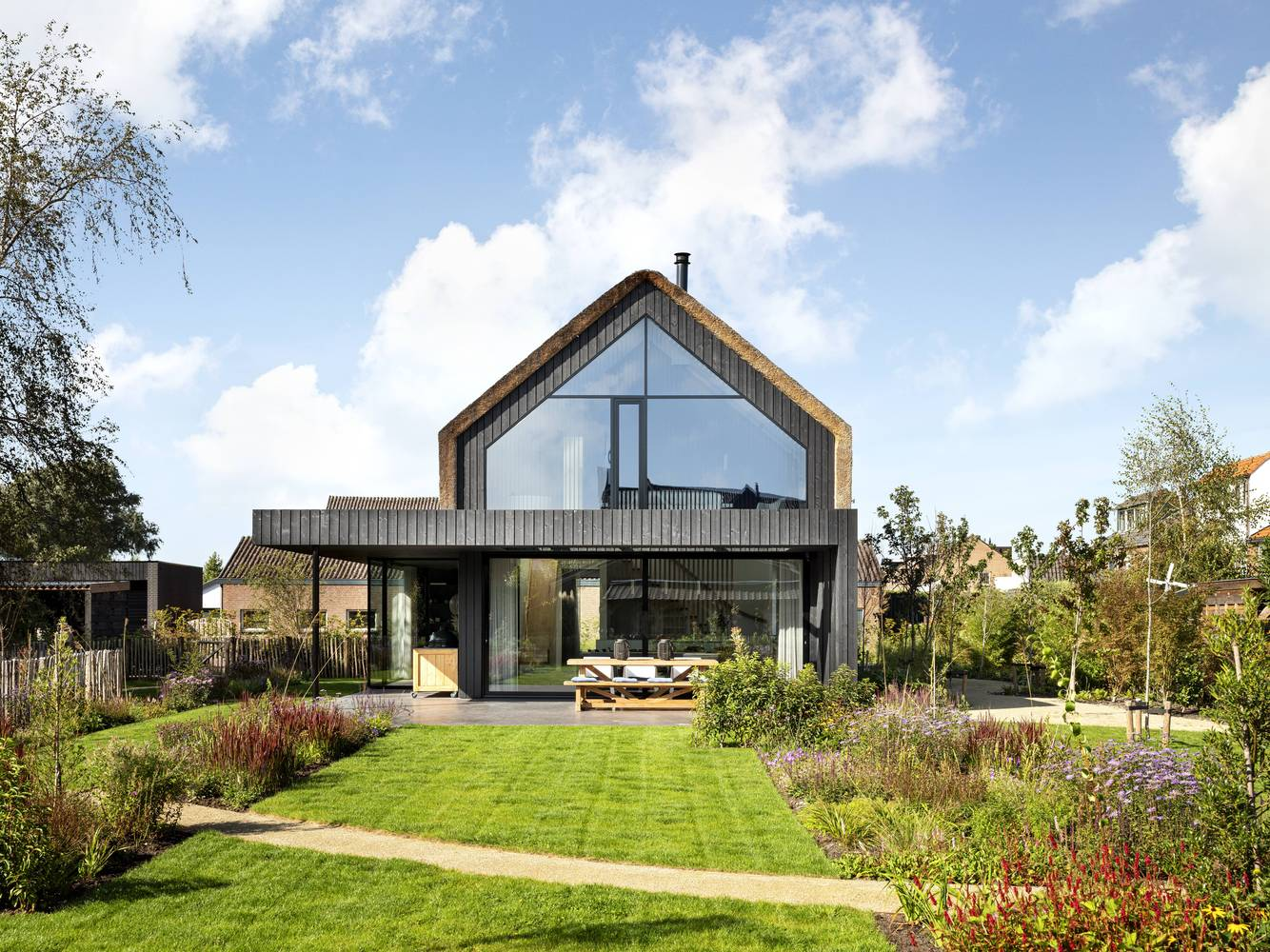 The rear of the house has these big, full-height windows that frame the lovely garden views