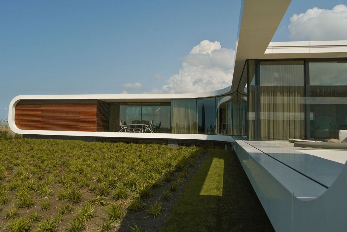 Villa New Water by Waterstudio.NL glass and wood facade