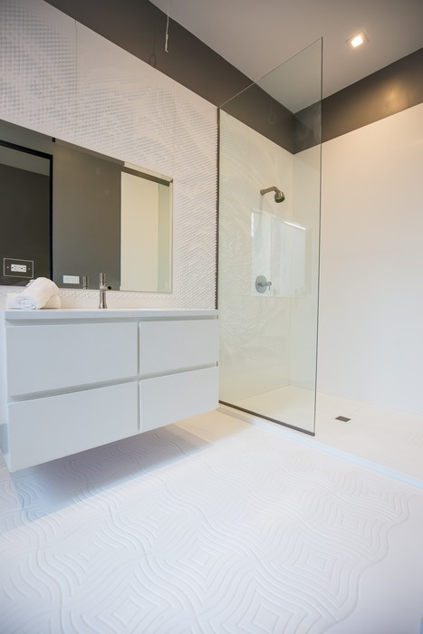 Wave House bathroom with open shower