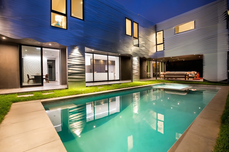 Wave House outdoor living space by the pool