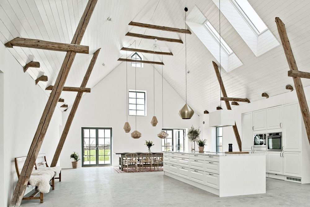 The open kitchen features skylights and the same monochromatic decor as the rest of the house