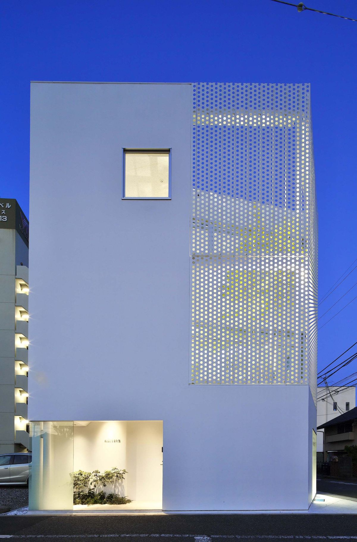White house with a perforated facade angle