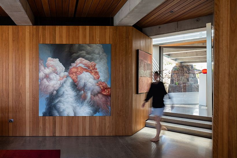 Wood-paneled interior walls and ceilings complement the polished concrete flooring