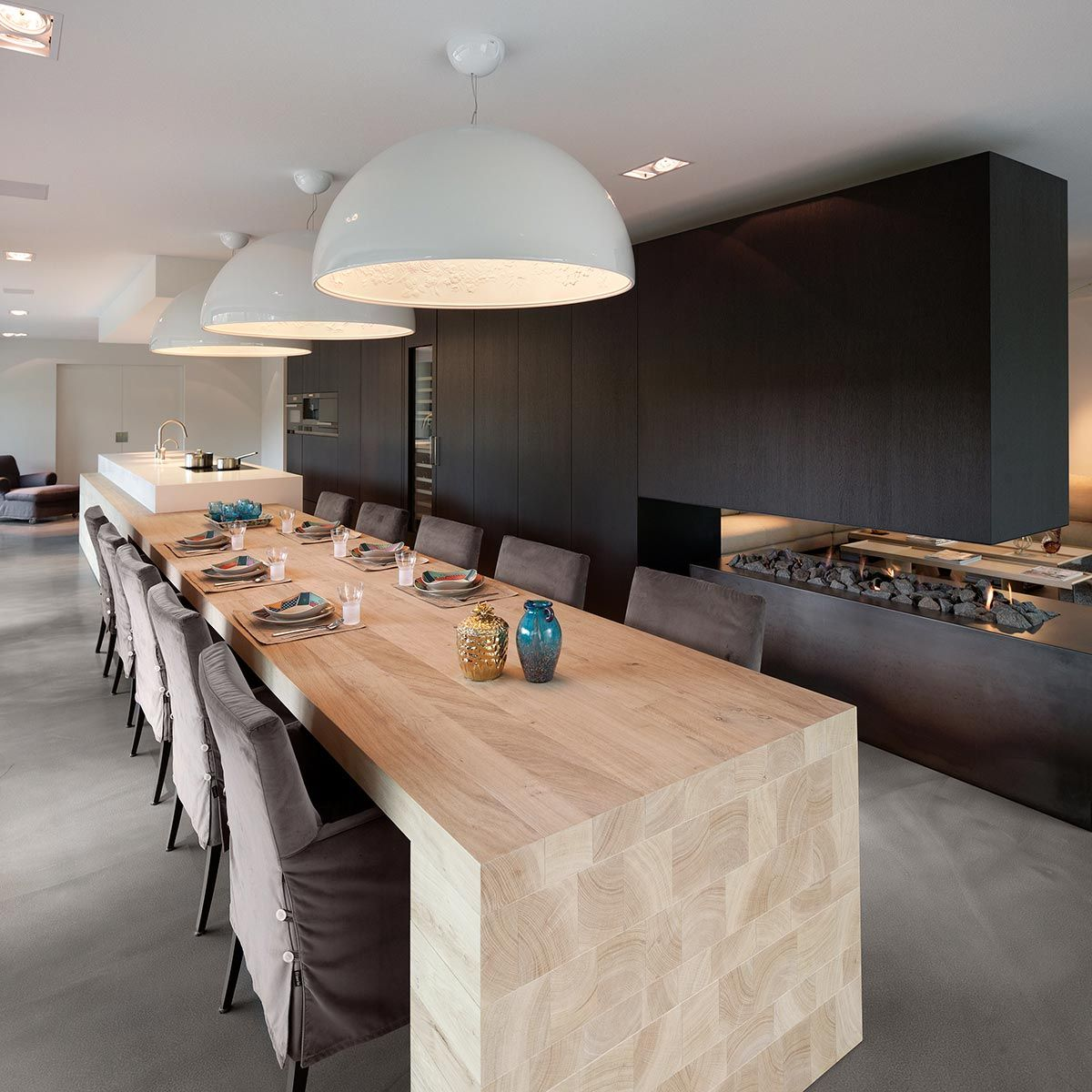 Woonhuis M residence makeover dining table pendant lamps