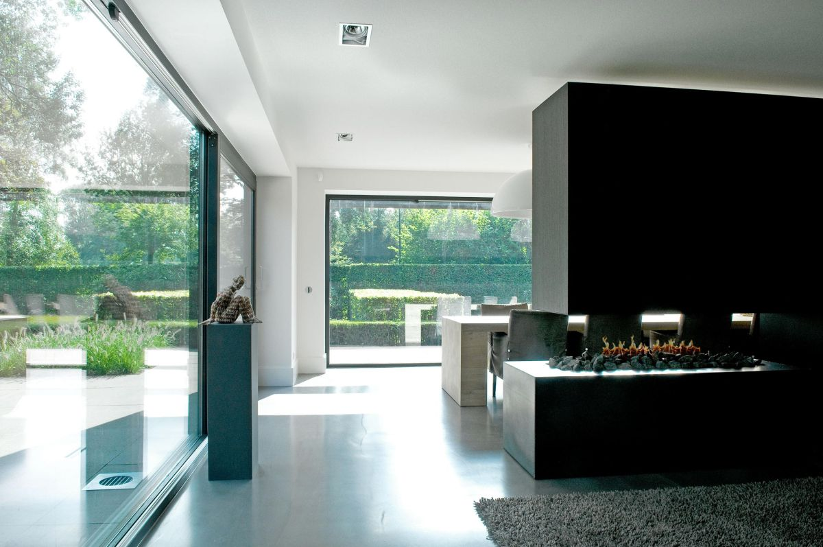 Woonhuis M residence makeover fireplace space divider