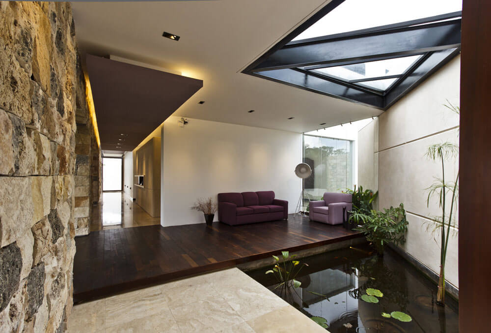 Yucatan cantilevered house indoor pond seating nook