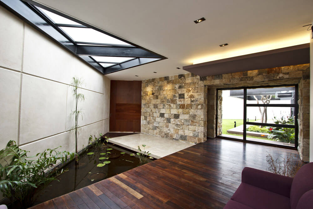 Yucatan cantilevered house indoor pond